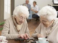 Two Senior Women Playing Dominos