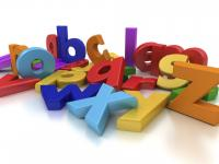 Jumbled multi-colored alphabet in a pile