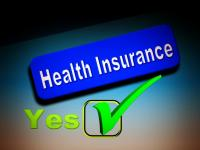 Blue Box with white letters saying Health Insurance and Yes with a checkbox underneath