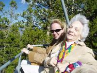 Young Woman and Senior woman smiling outdoors