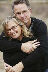 Happy Senior Couple Hugging and Wearing Glasses