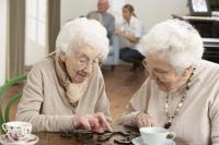Two Senior Women Playing Dominos
