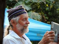 Senior Man wearing a hat and using tablet computer